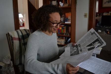 "Rebecca holds up a photocopy of an old newspaper article: ""Alberta's Ku Klux Klansmen"" by Richard DeCandole"