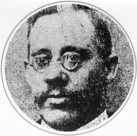 A black and white photograph of Constable Frank Beevers, wearing small round glasses.