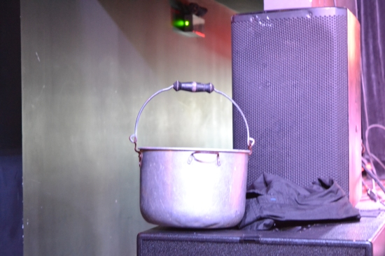 A metal bucket sits on a ledge.