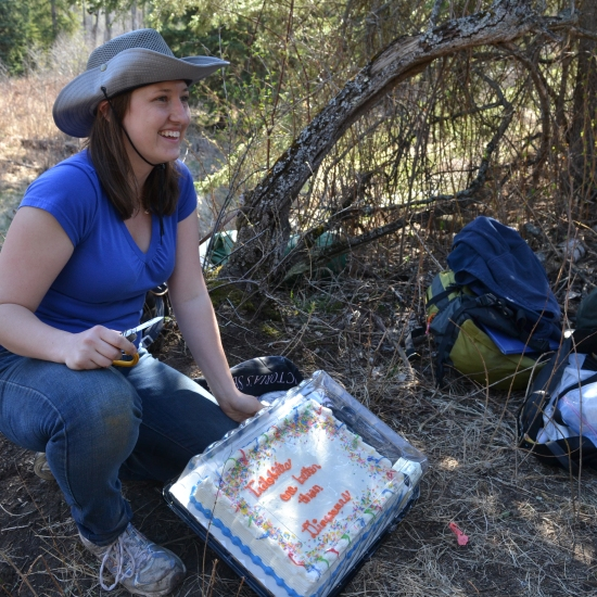 "Caroline and her cake. It says ""Trilobites are better than dinosaurs."""
