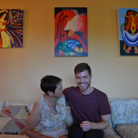 Lida and Kory in front of some of her paintings