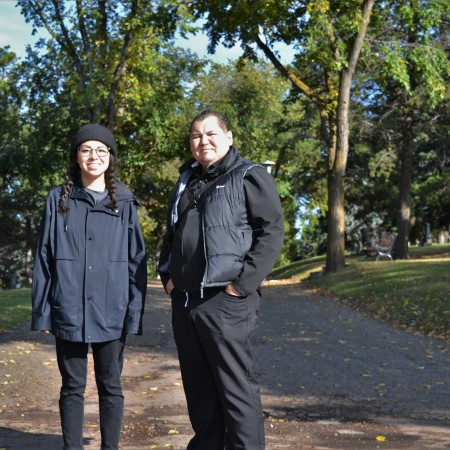 Lauren Crazybull and Chief Calvin Bruneau at the Mount Pleasant Cemetery.