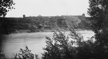 Fort Edmonton sits on top of the river bank in this photo from the south side of the river (City of Edmonton Archives EA-10-3248)