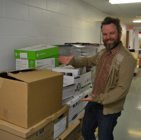 Braden Cannon showing off some of the Alberta Ballet records that the PAA hasn't had a chance to process yet.