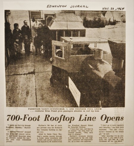 Article headline: 700-Foot Rooftop Line Opens. There's a photograph of people lining up to enter a train on the roof of the Bay.