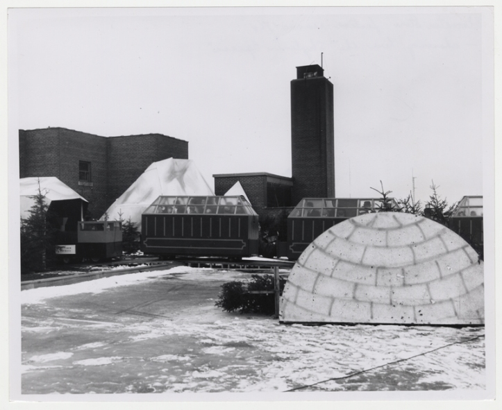 The train runs behind a prop igloo on the roof [Hudson's Bay Company Archives, HBCA 1987-363-E-610 - 52]
