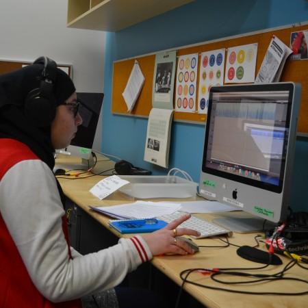 Nuha Taha editing at a Mac.