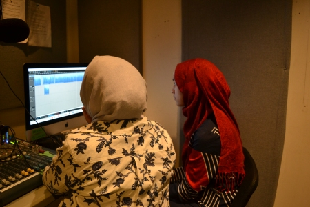 Laila and Mariam editing in Studio B at CJSR.