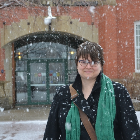Susan in front of the Prince of Wales Armouries, where the City of Edmonton Archives live. There's a lot of snow.