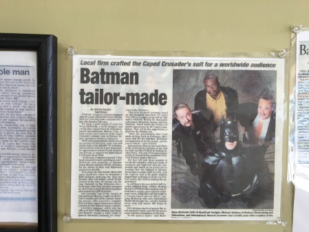 An article about the Batman story hangs on Mike's wall
