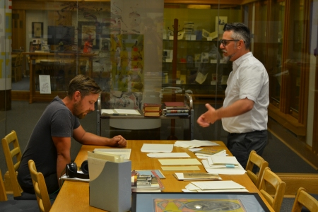 Dustin and Jeff look through materials at the Bruce Peel Special Collections