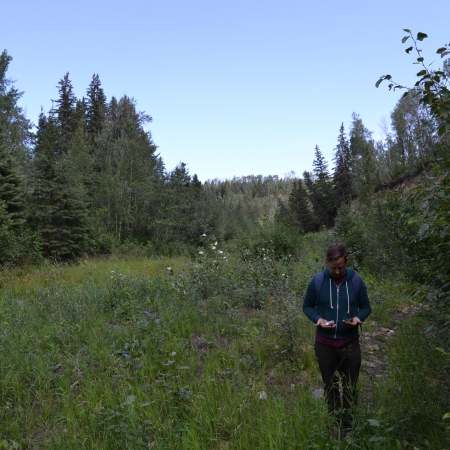 Dustin stands amid a lot of trees at Coates