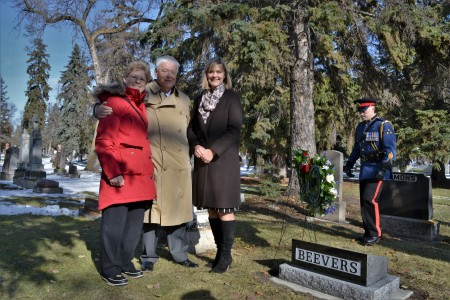 Sheila Thomas stands with Graham Beevers and Candy Johnson by Frank Beevers' new headstone