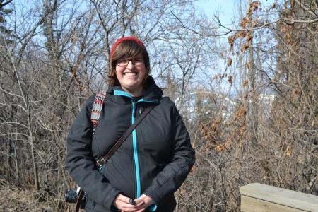 Amandah van Merlin, with the Edmonton stretch of the North Saskatchewan River behind her.