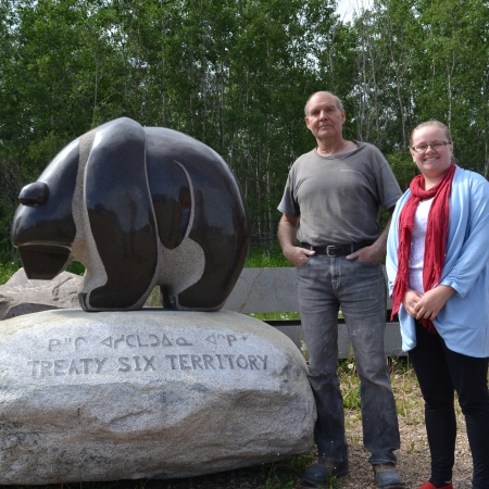 Stewart Steinhauer and Shelley Jodoin-Chouinard stand beside a new bear sculpture headed for MacEwan University